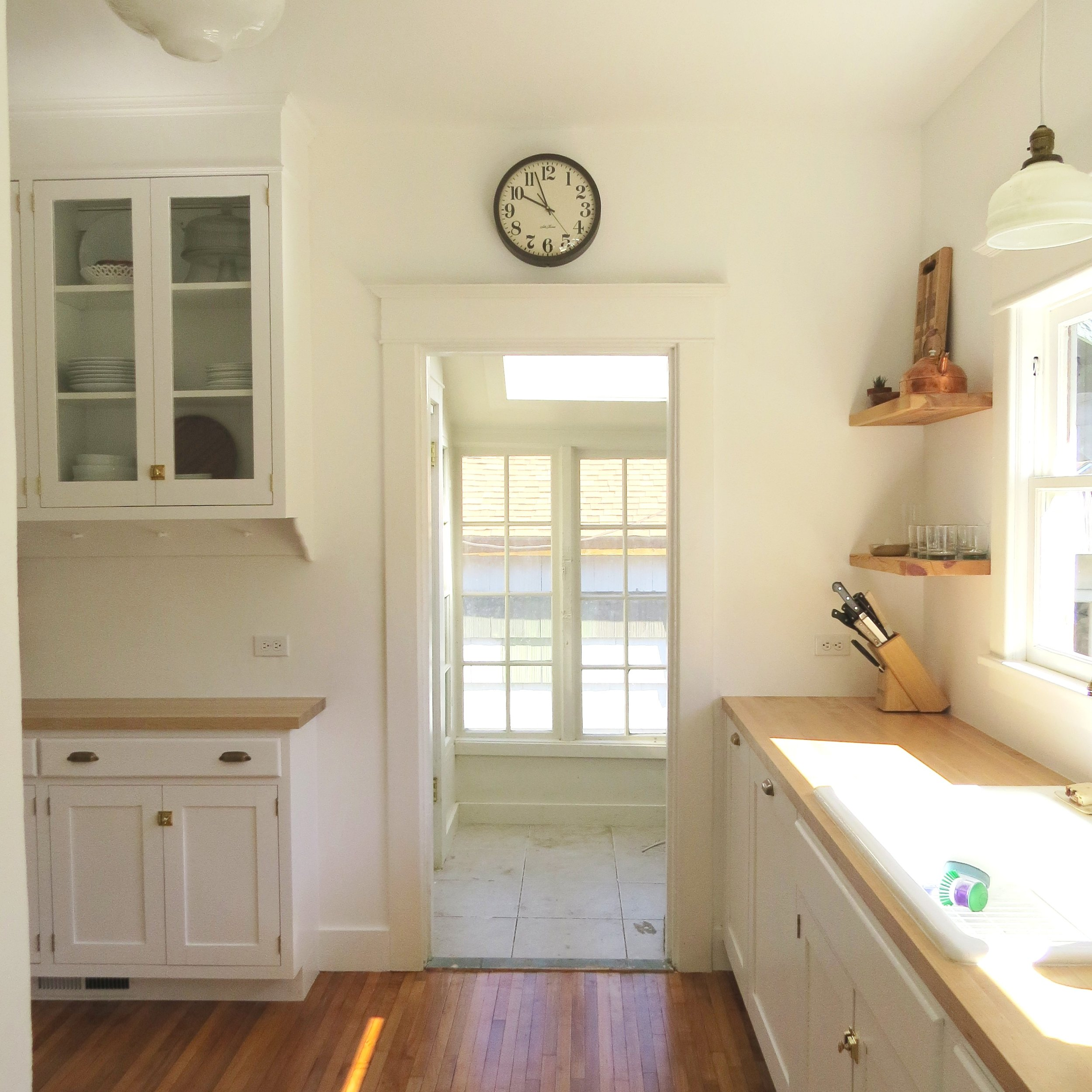 craftsman kitchen with white cabinets and butcher block counters