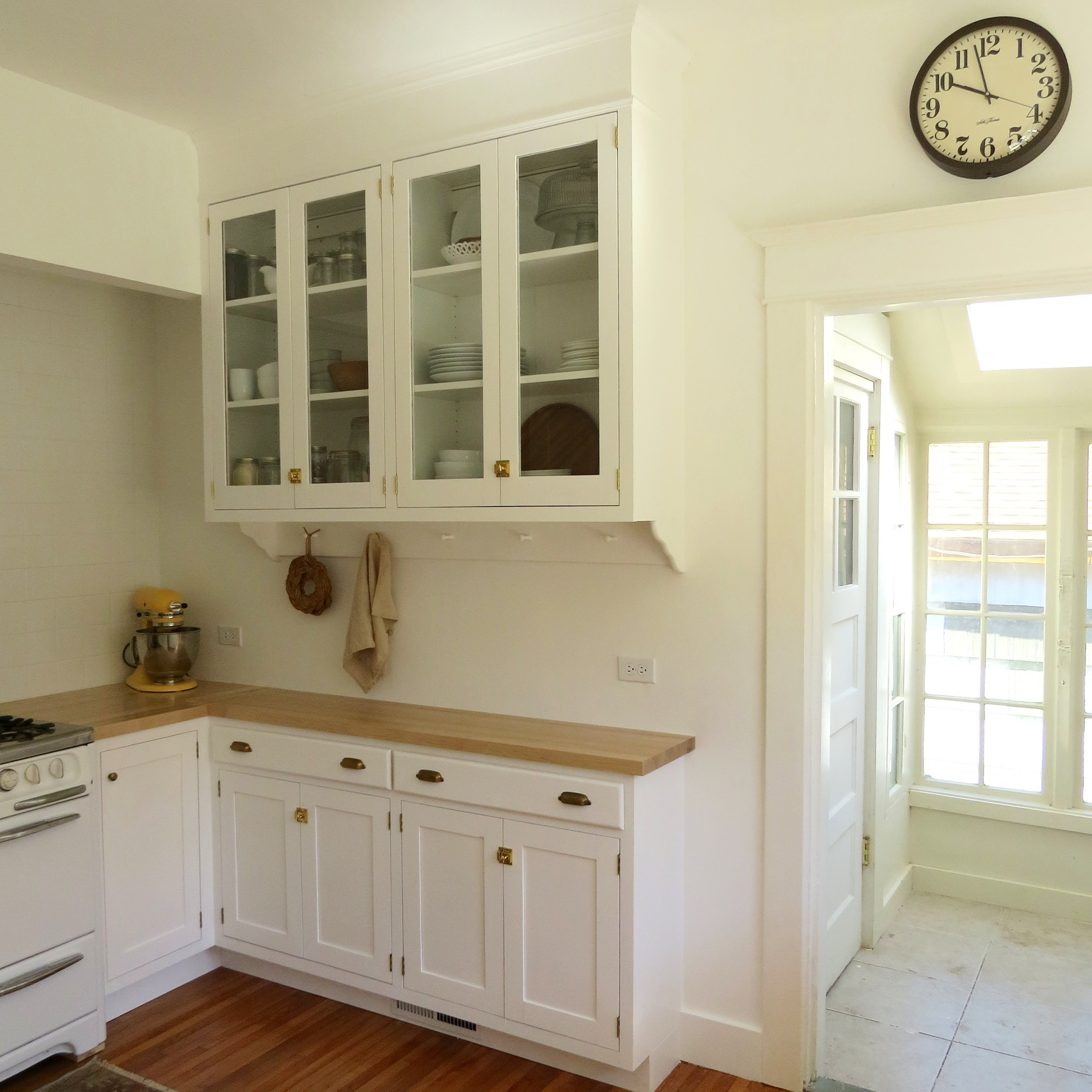 white kitchen with butcher block counter tops