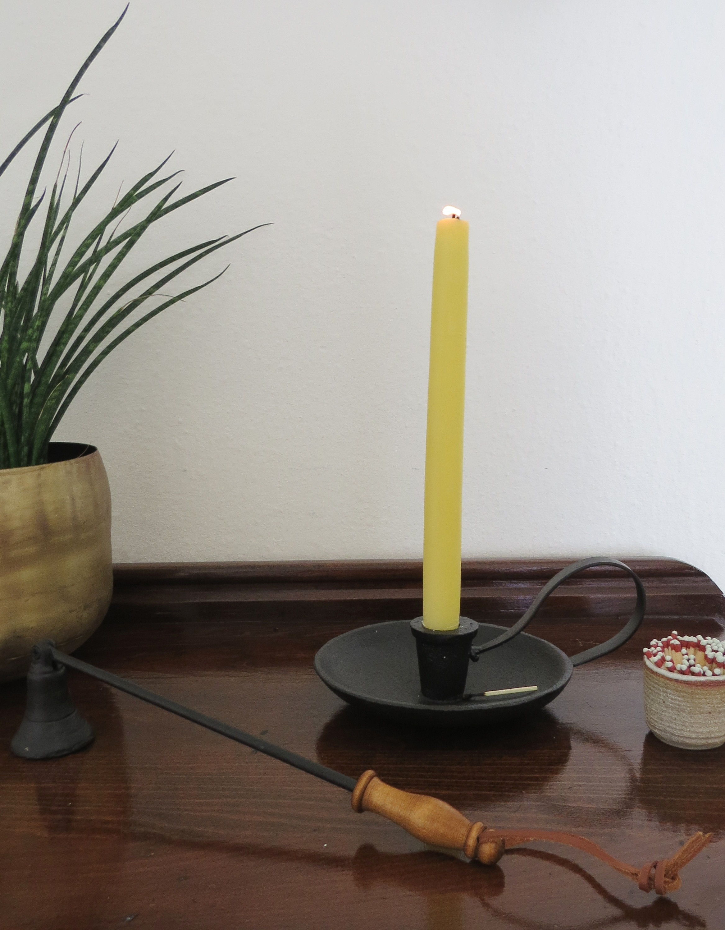 cast iron candlestick with beeswax taper candle