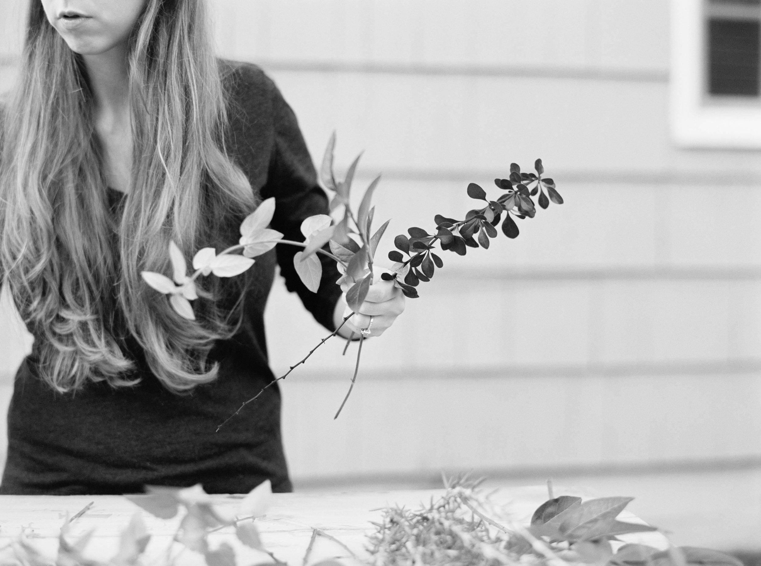 a florist at work making a wedding bouquet