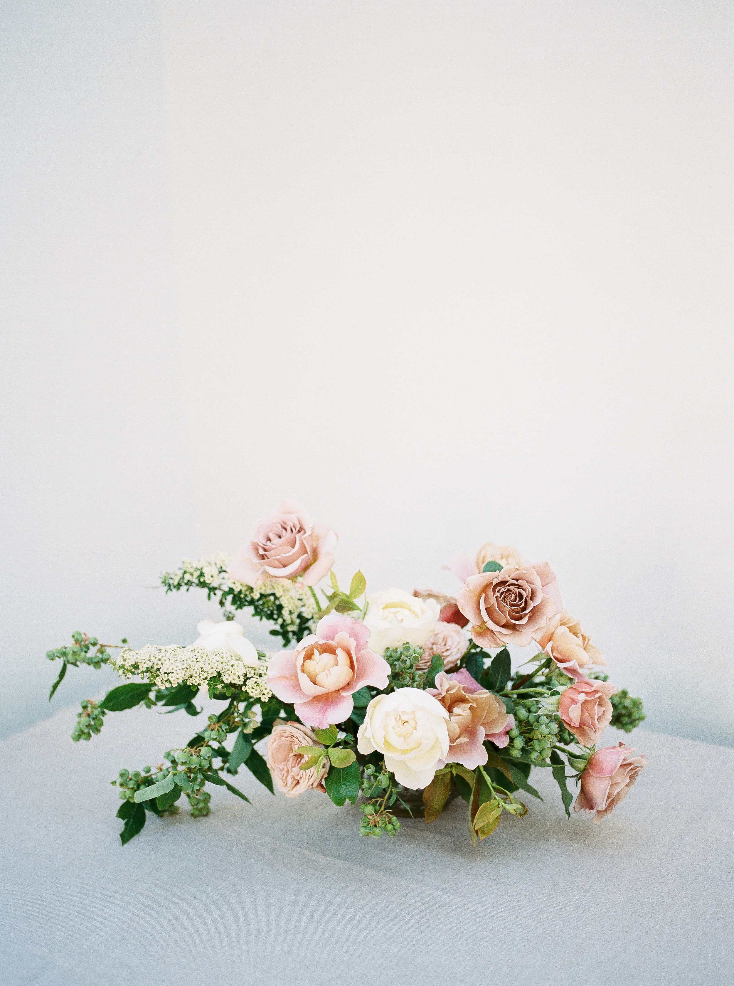 mauve, light pink and white summer flower centerpiece