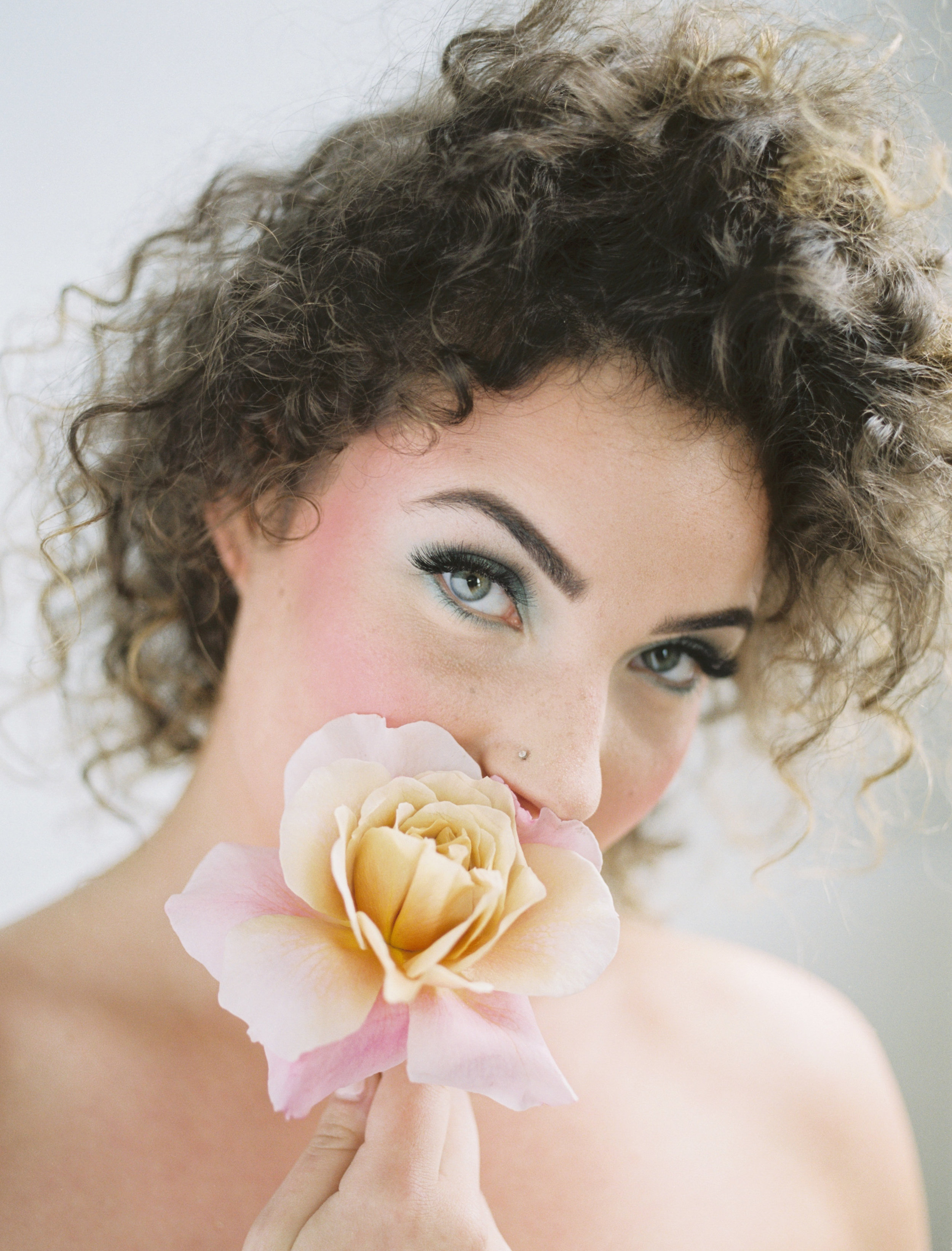 Inspiration and ideas for wearing fresh flowers in your hair for brides, weddings, or any event from livingforaged.com