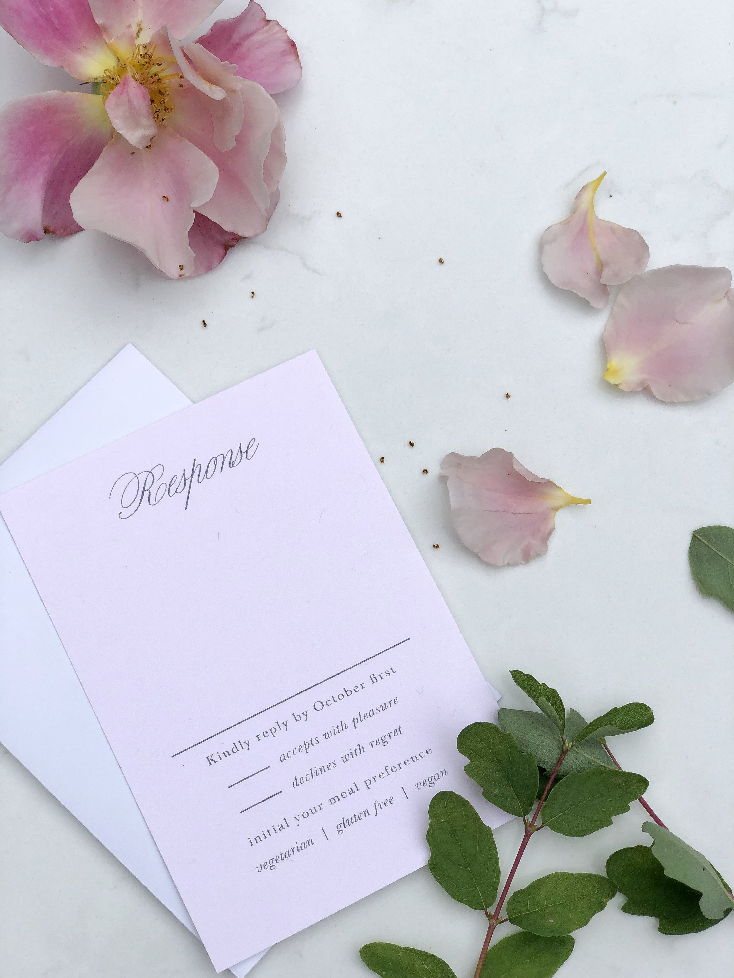 pink water color flowers wedding invitation on livingforaged.com