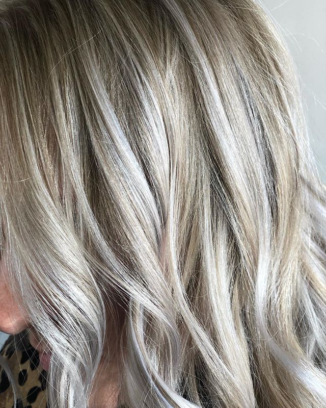 "Does this look WARM ☀️ or COOL ❄️ to you? 🤔  This is actually the same client as the icy blonde I posted a while ago. Kate is naturally light so when we highlight her and tone, those highlights pieces pick up the pop of iciness!  In reality, her hair is both warm AND cool but views as ""cool"" because the majority is highlighted.  Keep in mind when you are asking for cool toned hair, it may not always be what you think!  #raleighhairstylist #919hairstylist⠀ #NChairstylist #Raleighhair #caryhair #raleighsalon #carysalon #socialloftie⠀ #hairinspo #raleighblog #instahair #hairblogger #blondespecialist #balayagespecialist #hairtrends⠀ #balayage #blondehair #mediumhair #highlights #beachywaves⠀ #beautifulhaircolor #ncblogger #nchairblog #hairhealthart #surfacehair #springhairinspo #summerblonde #foilyage #blondehaircolor #blondehairgoals"