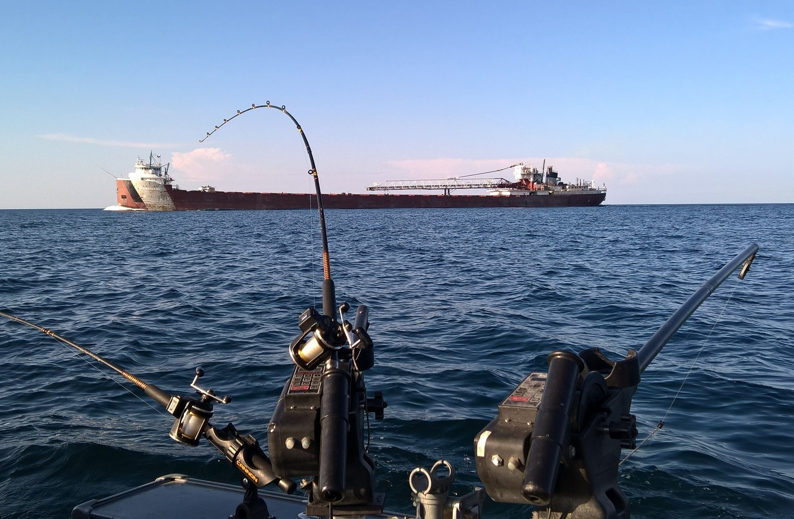 Watch the Great Lake Freighters go by while Fishing with TLC Charters.