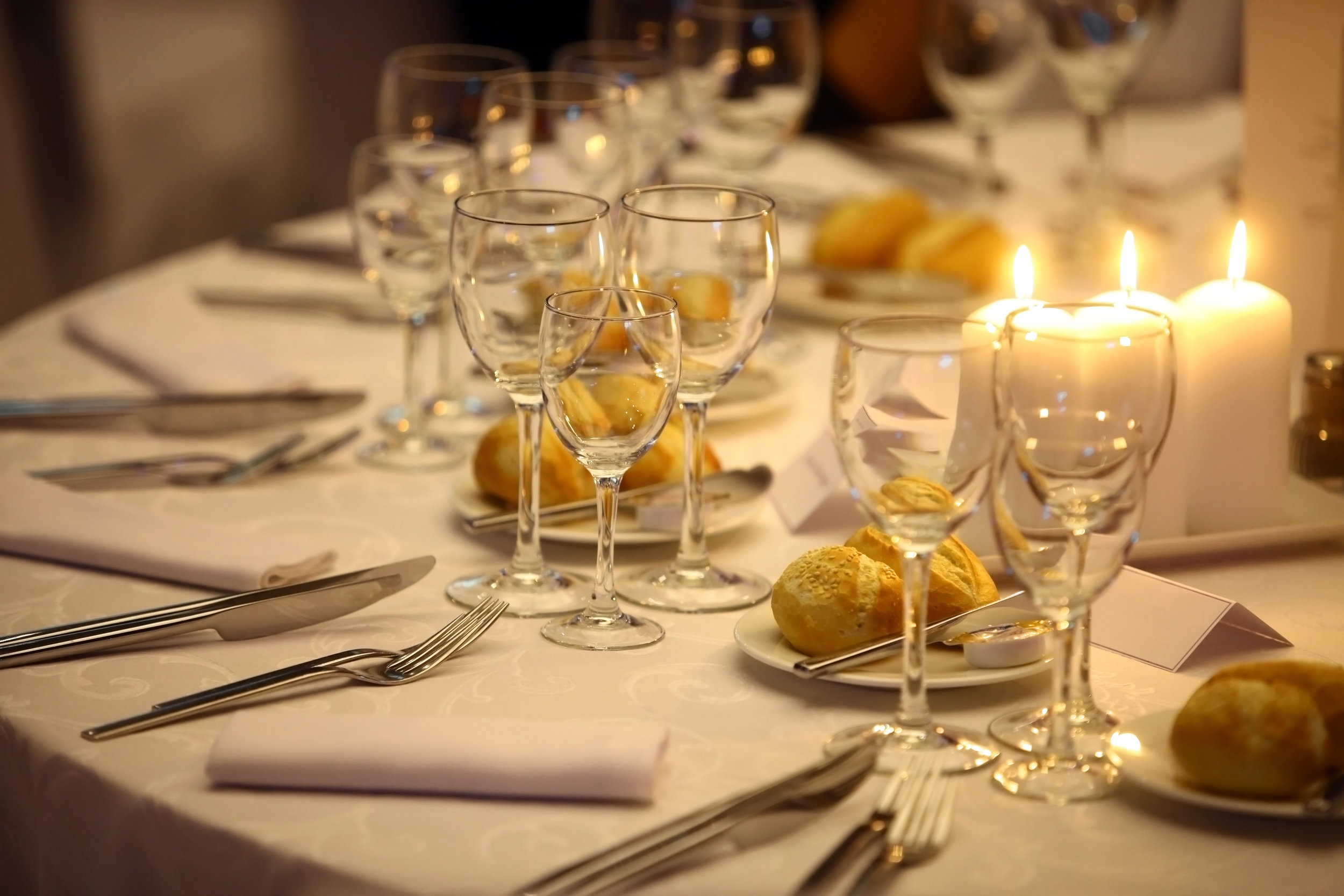 F&G Partial view of set table with candles.jpg
