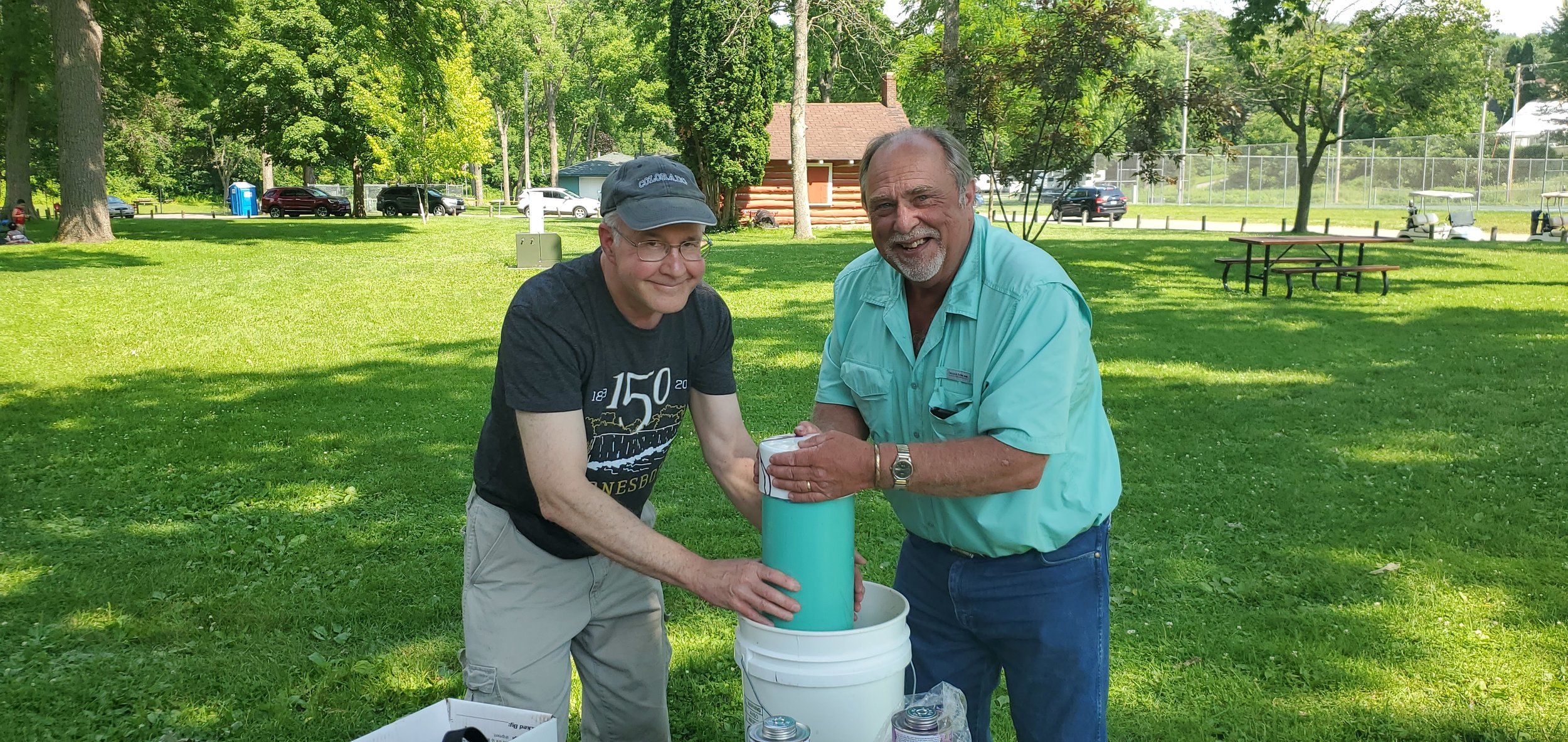 Peter Torkelson and Walter Bradley preparing Lanesboro Time Capsule