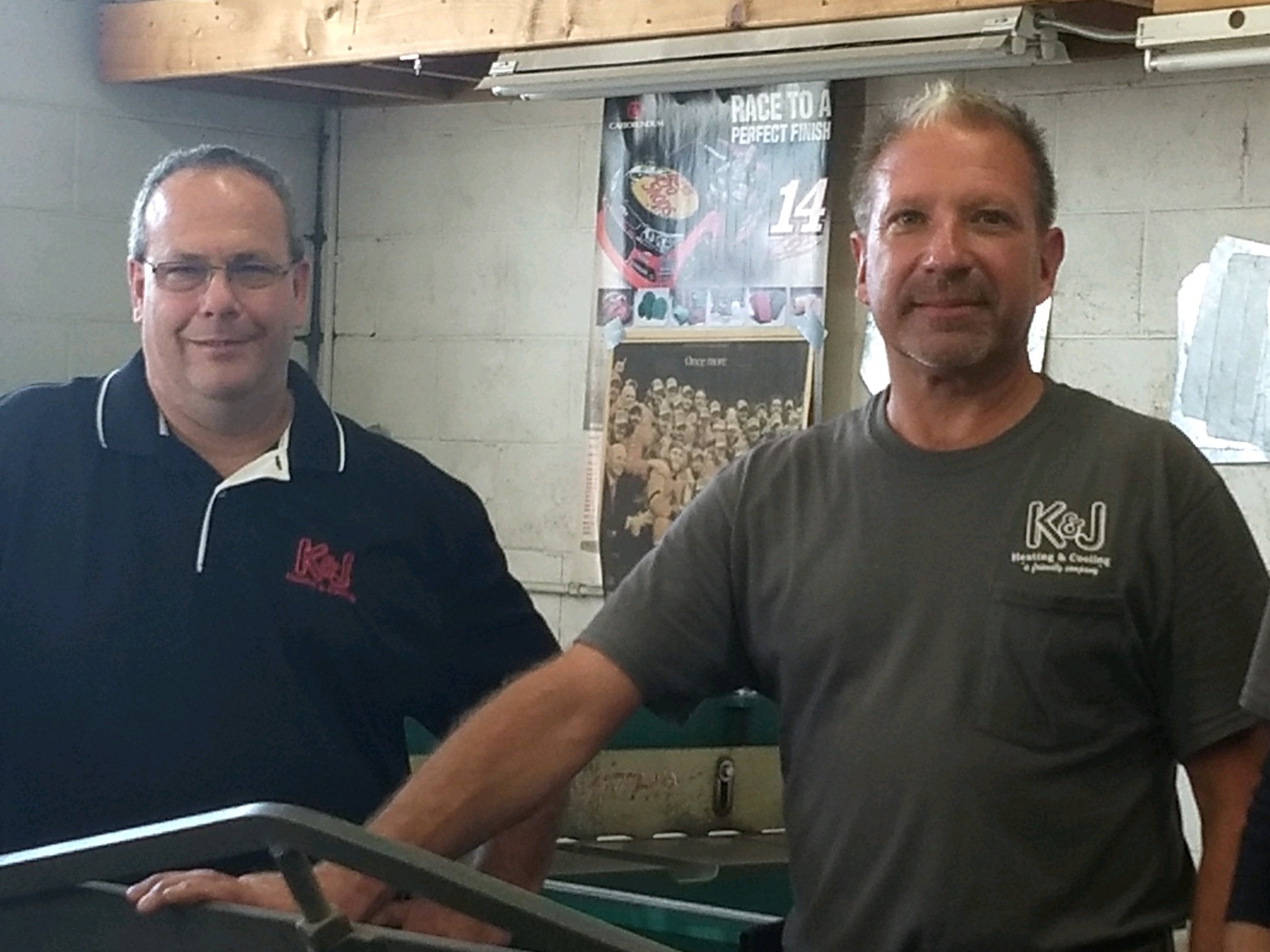 K & J Heating and Cooling, Inc. Owners Kip and Jeff by Fully Stocked HVAC Repair Service Vehicle