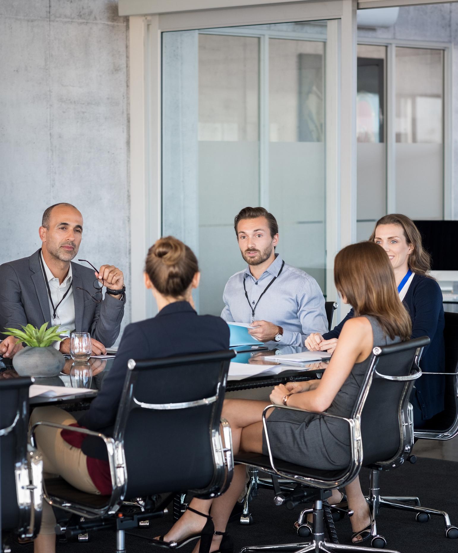 bigstock-Business-people-sitting-in-boa-206016238.jpg