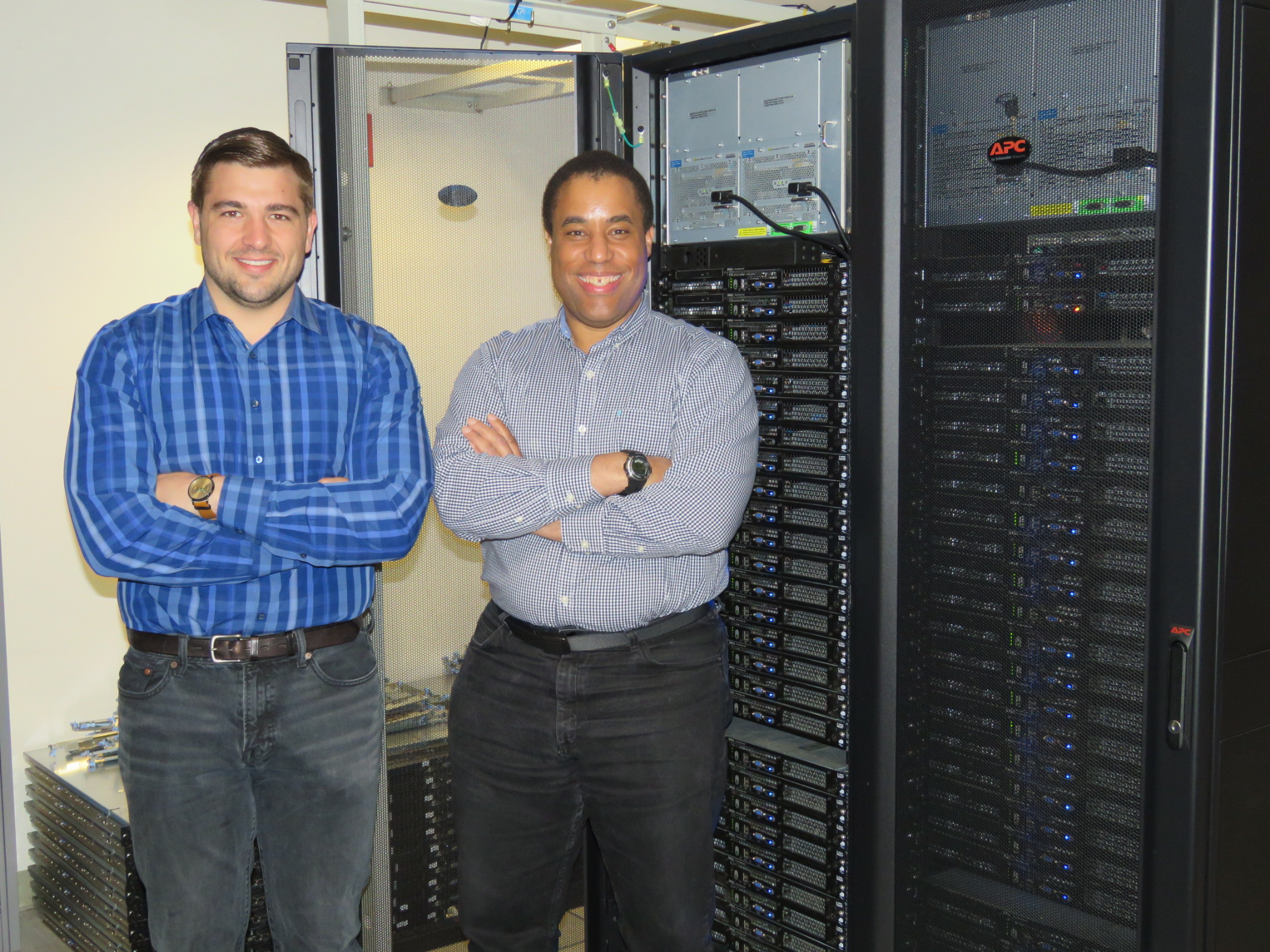 Taner (left) and Anthony (right) at UC Berkeley next to their compute cluster