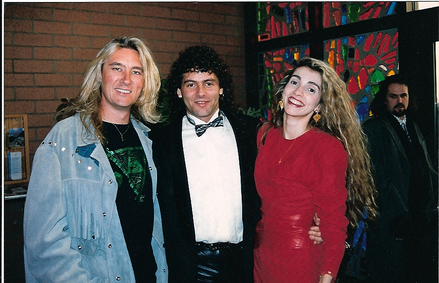 Steve at a wedding with his wife Joanne and Joe Elliot.
