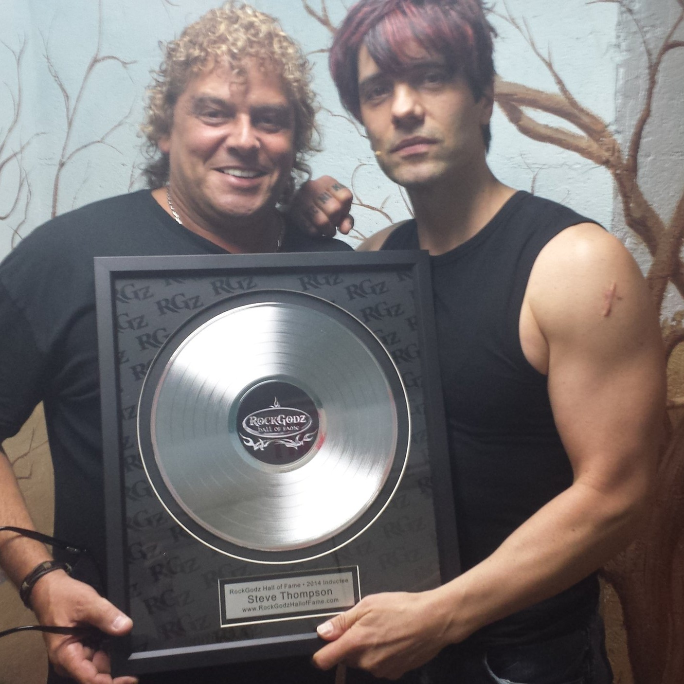 Criss Angel giving me the award for Rock Godz Hall of  Fame in Las Vegas, NV.
