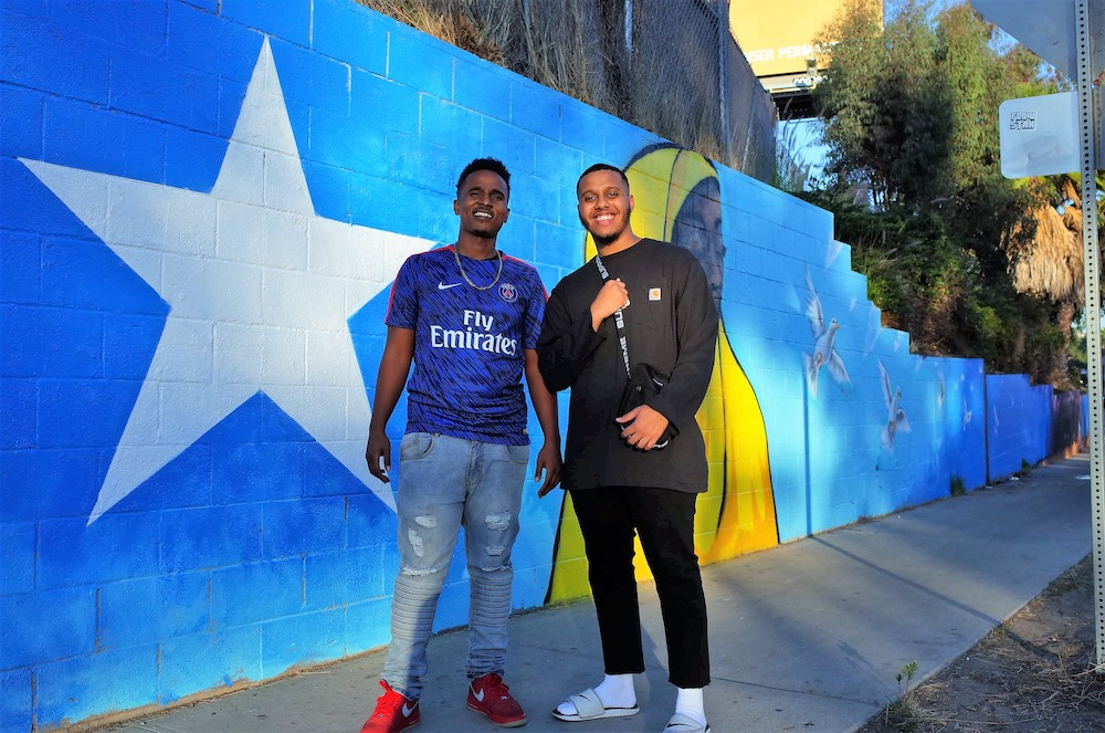 Haadi and Mozayy in front of mural HQ.JPG