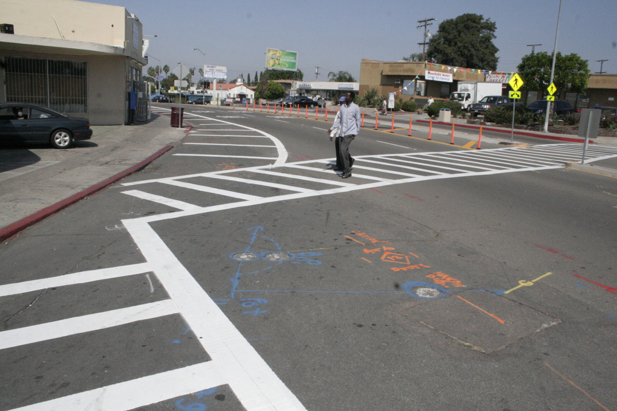 The intersection at 50th and University Ave with paint and cones.