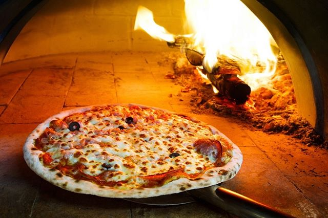 Want to be warm and have something yummy for lunch or dinner?  The woodfired pizza oven is heating up as we speak at Patacca Pizzeria in Morrison Square.