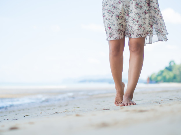woman-walking-on-sand-beach-closeup-detail-of-female-feet_53476-2125.jpg