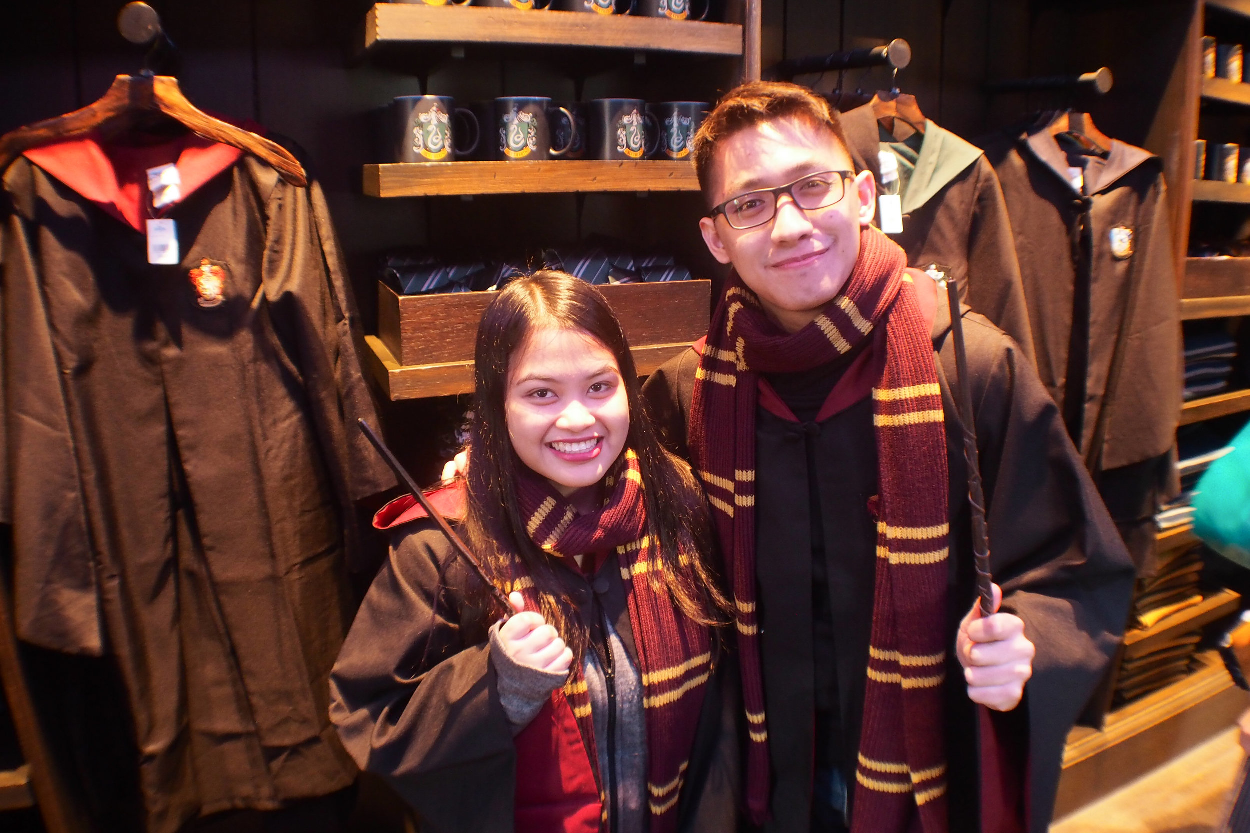 Got our wands and scarves! They're damn expensive. Haha! To complete our outfit for the picture, we just borrowed the robes from the store. The staff didn't mind!