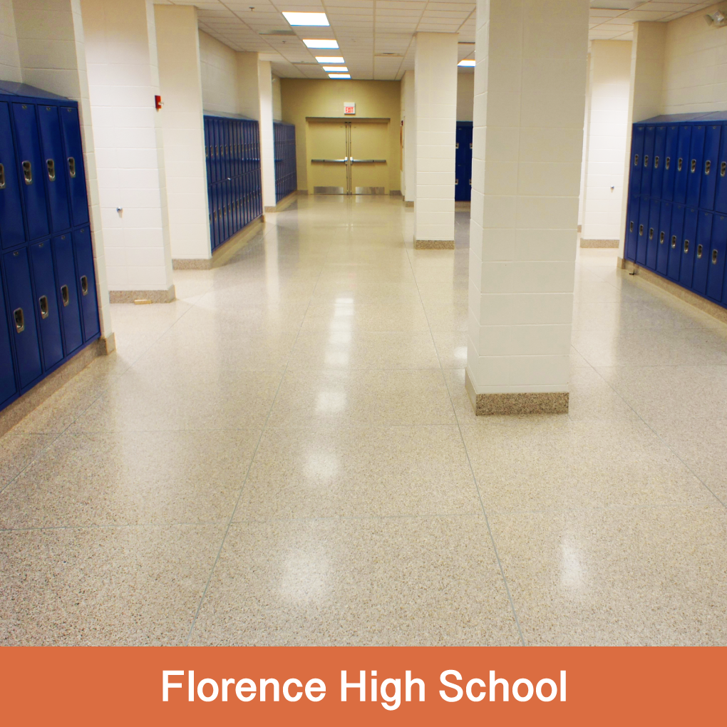 """The Florence Freshman Center Terrazzio application was an addition to the high school. We were asked to match existing poured-in-place terrazzo, and did so with a more consistent look and distribution of aggregates than the original poured terrazzo floor. Please notice the 6"""" high Terrazzio Wall Base around the perimeter."""