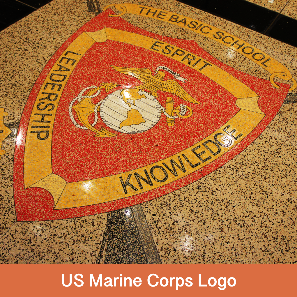 """Every day, Marine Troops walk on 120,000 square feet of Terrazzio after coming in from Field Exercises wearing combat fatigues with lugged boots filled with rocks and mud. After the first Terrazzio was installed, a Marine Officer called saying, in a Commanding Voice """"… you have great STUFF, Sir. This is the best STUFF I've ever seen….. We are tough on floors and every day this STUFF looks great.""""  The Marine Corps Shield was created with 4'x8' Terrazzio Panels to present the look of traditional terrazzo, with virtually no joints. Please contact us if you have a special logo or design for your floor."""