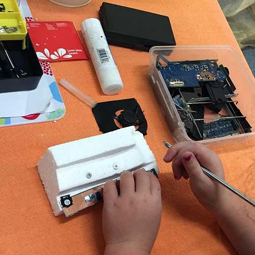 Repurposing-parts-at-the-Tinkering-Table.jpg