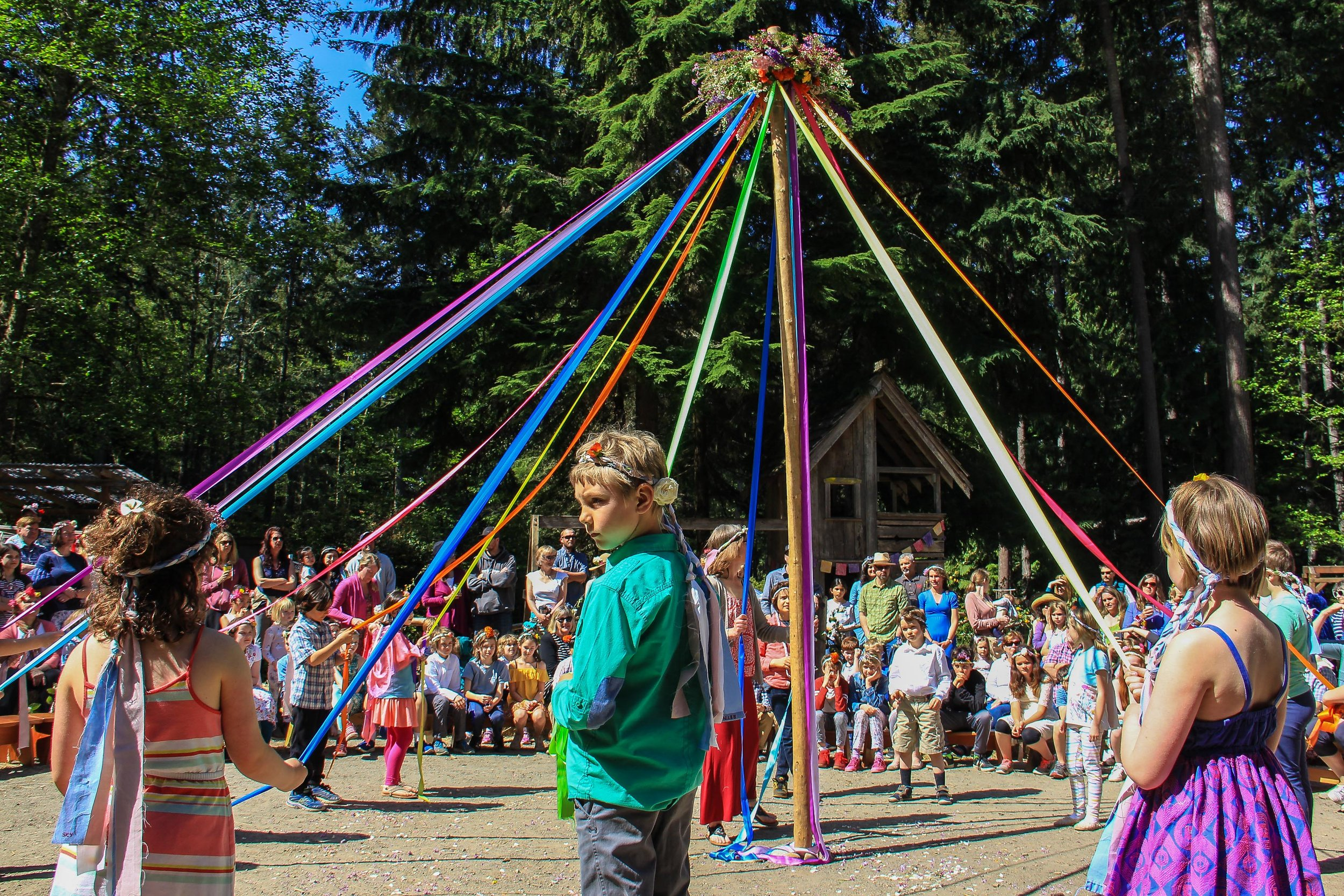 Please come to our lovely woodland campus and celebrate Spring! MayFaire is a festival day of rebirth and renewal, a time for singing and festooning the world with flowers. There are crafts, activities, and field games for the whole family; songs, food and, of course, the MayPole!