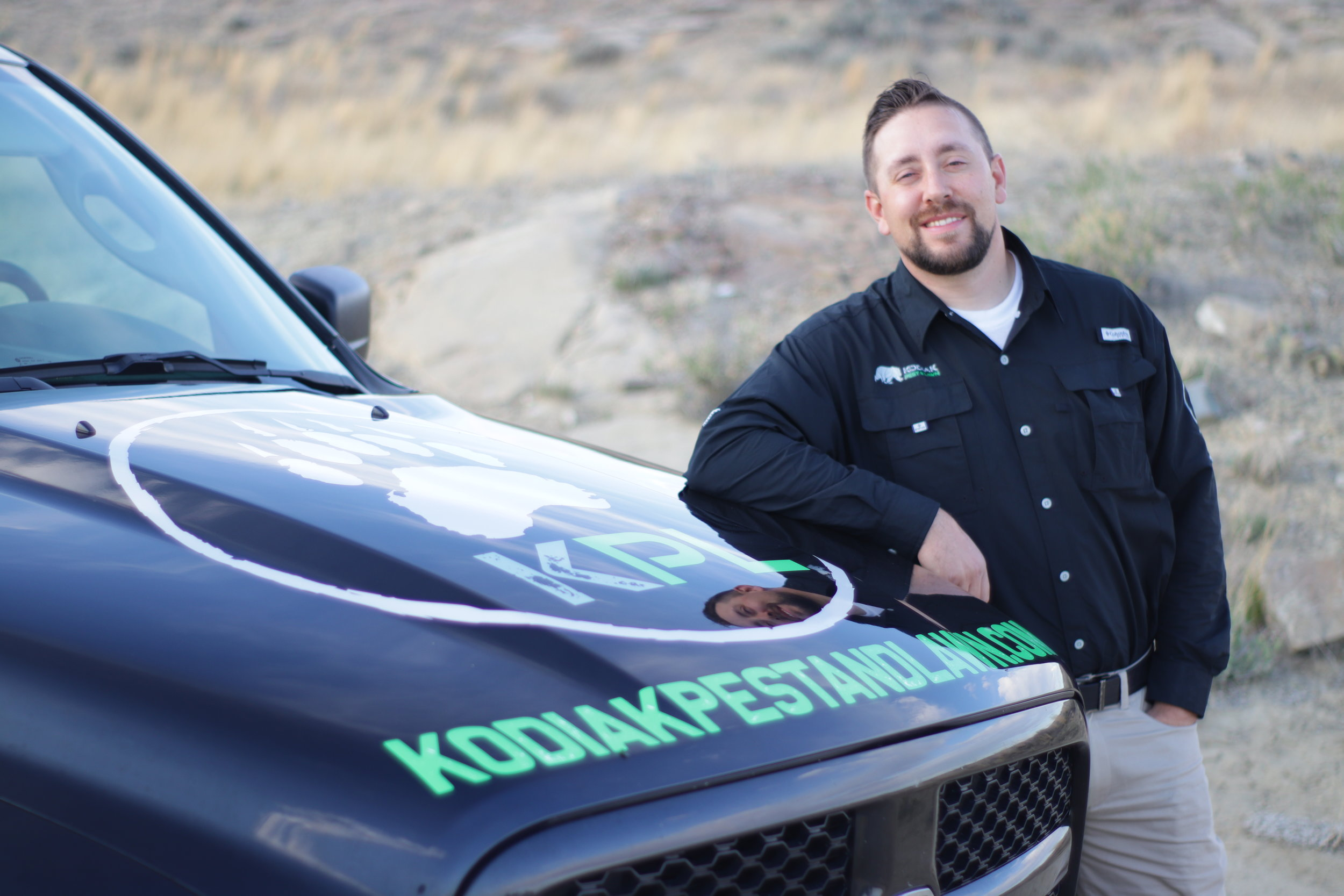 Picture of Jacob and the pest control truck.JPG