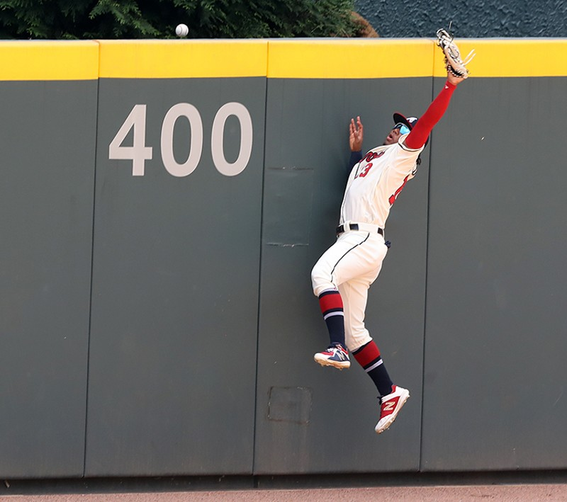 Curtis Compton  The ball careens off the glove of Braves outfielder Ronald Acuna beyond the SunTrust Park wall.
