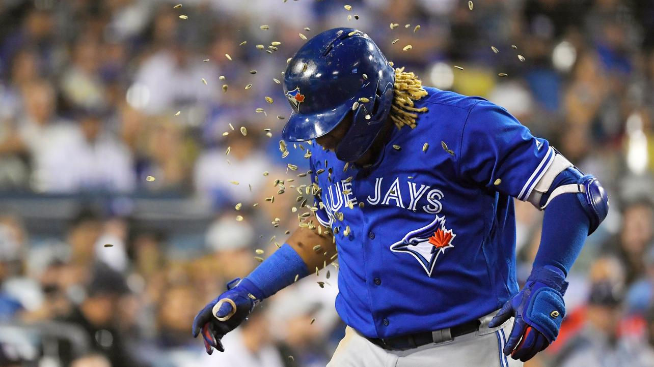 Vlad Guerrero Jr getting showered with seeds.