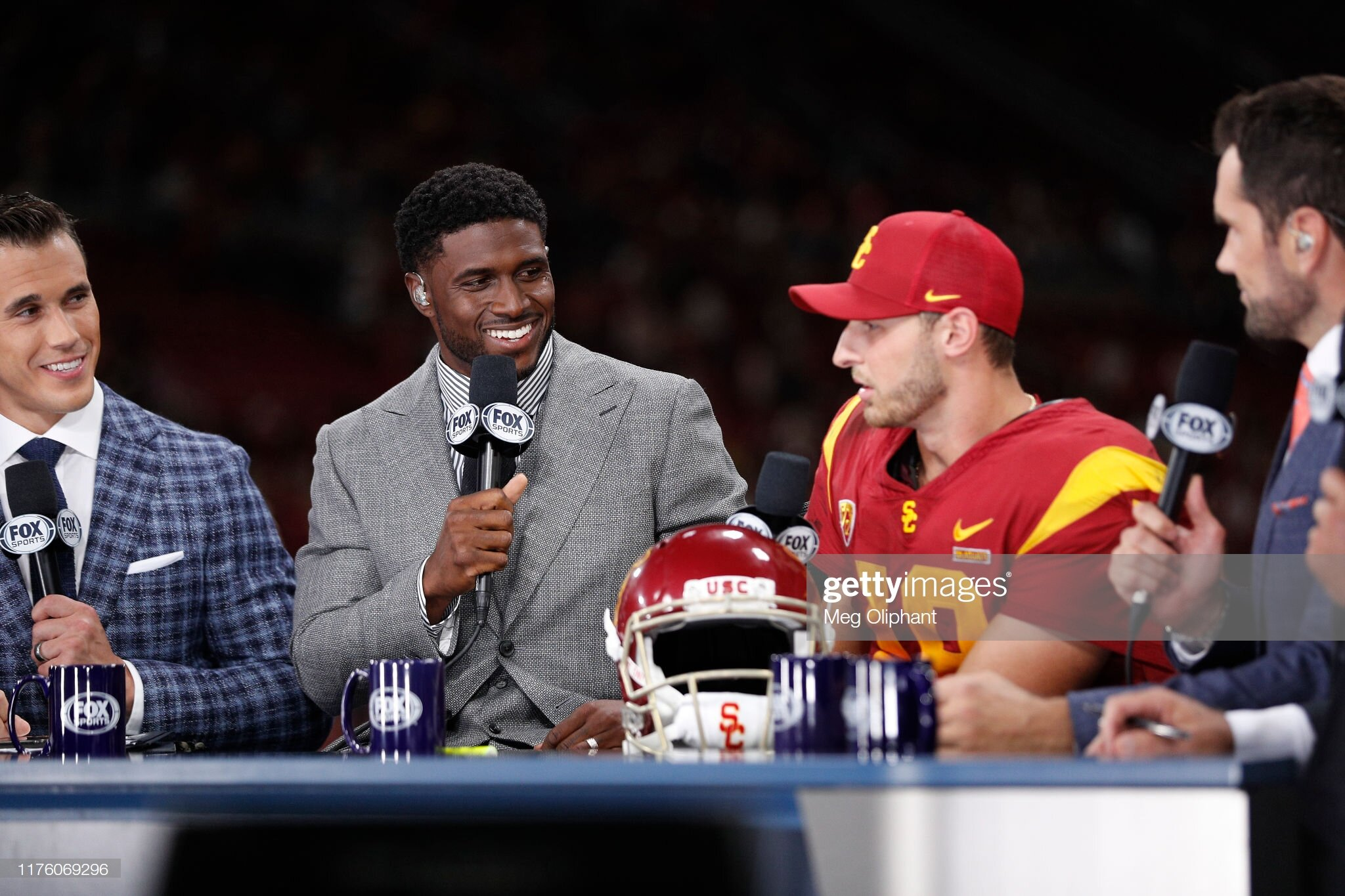 Fox Sports commentators Brady Quinn, Reggie Bush, and Matt Leinart congratulating Matt Fink.