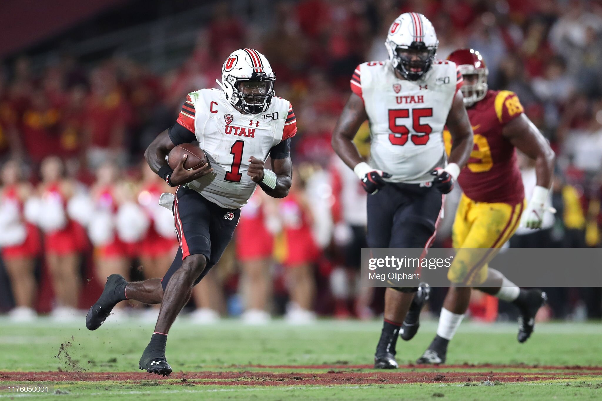 Utah quarterback Tyler Huntley evading pressure.