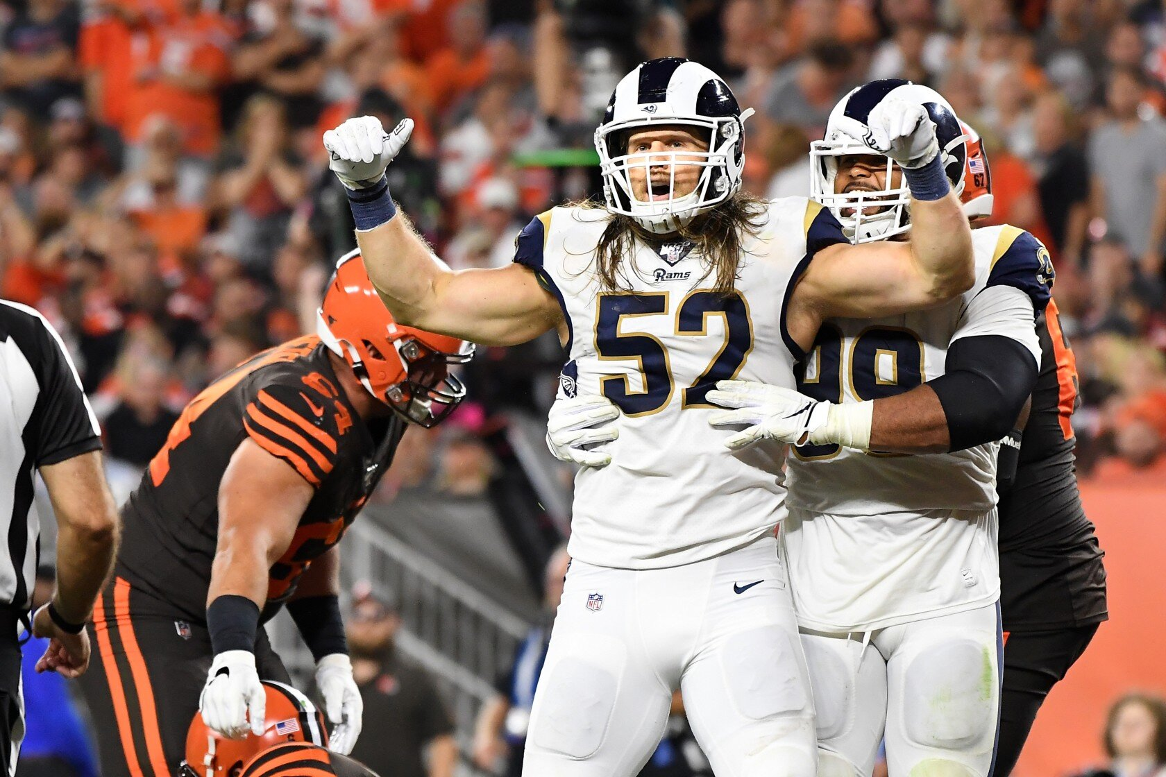 Clay Matthews III & Aaron Donald celebrating a sack.