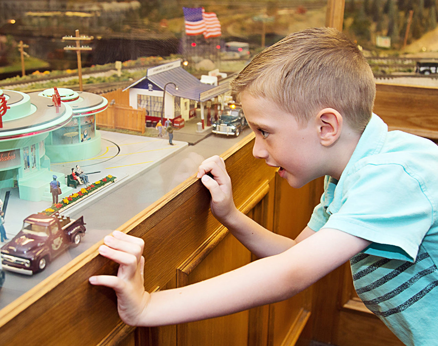 boy-watching-model-trains