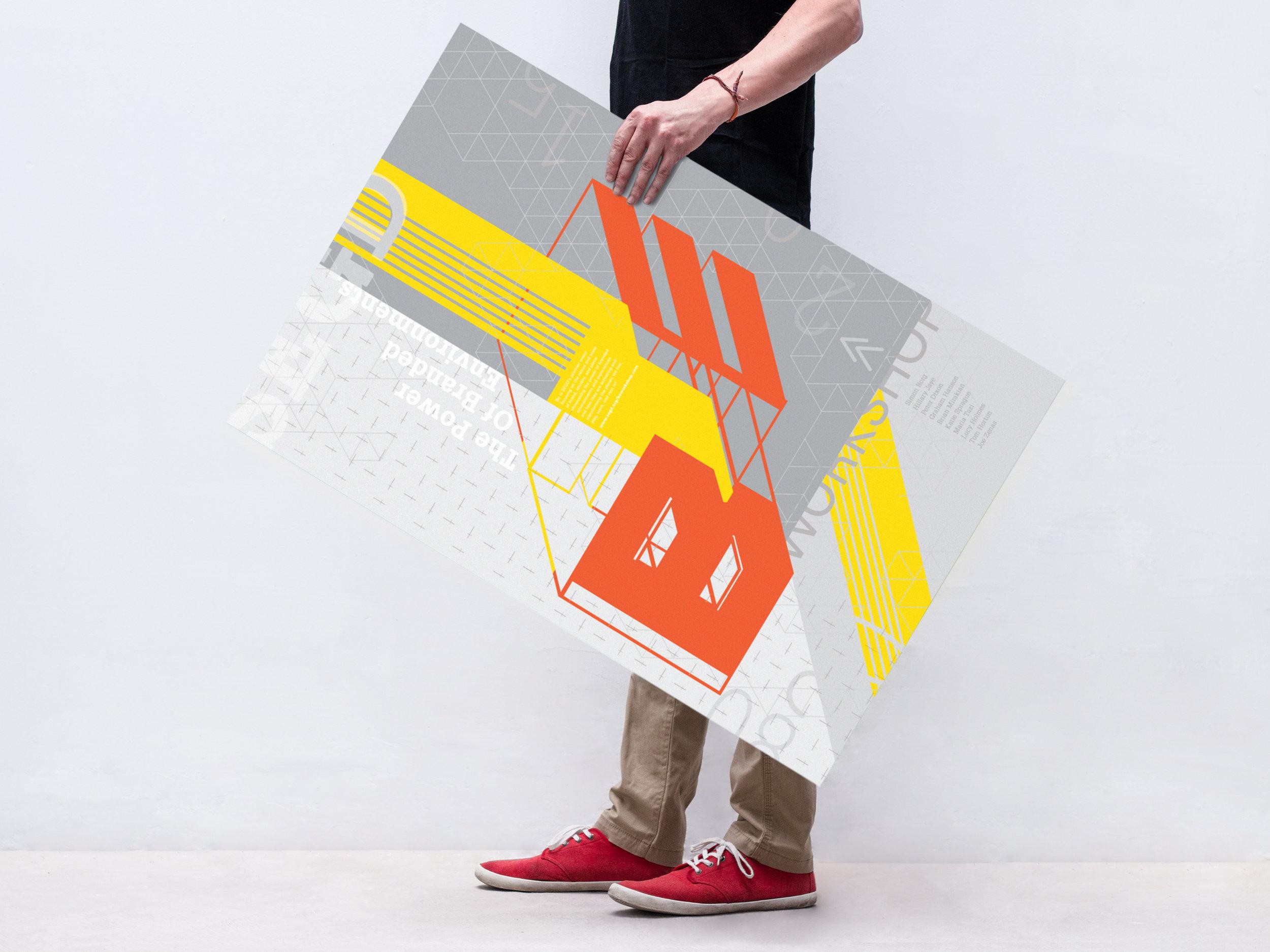 Man Holding a Poster Mockup.jpg
