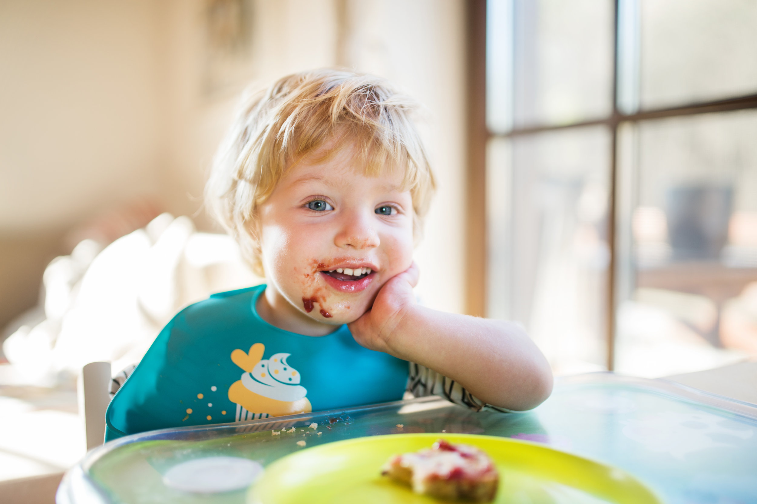 a-toddler-boy-eating-at-home-PGZ9M57.jpg