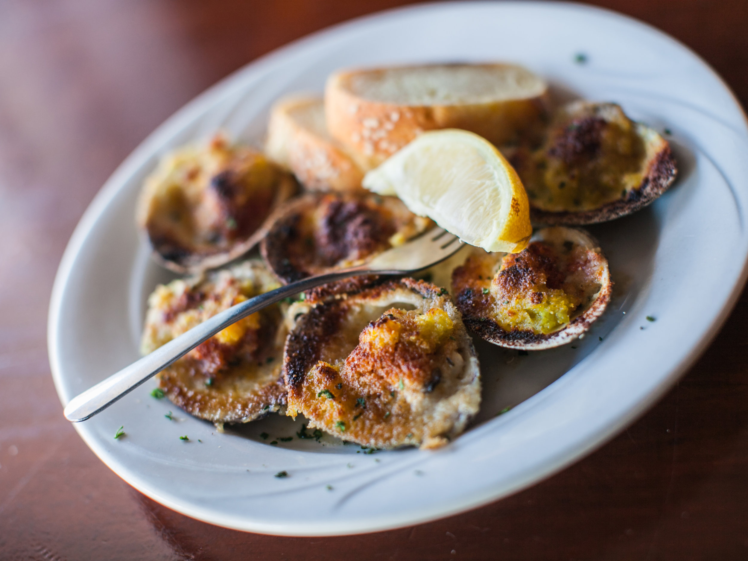 The Baked Garlic Clams is a staple at Mud City, the Black Whale and Ship Bottom Shellfish. Photo: Ann Coen.