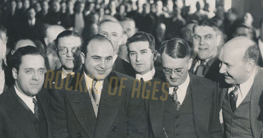"Al Capone is all smiles after being arraigned in Chicago Municipal Court on a charge of being a ""Common Vagrant."" This photo was shot while Capone was under a federal sentence of six months for contempt of court while awaiting trial on income tax charges."
