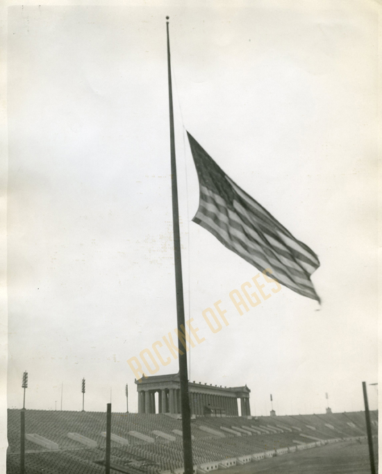 The flag flies at half-mast in Soldier Field, Chicago, on April 1, 1931, the day after Knute Rockne lost his life in a plane crash… CREDIT: International Chicago