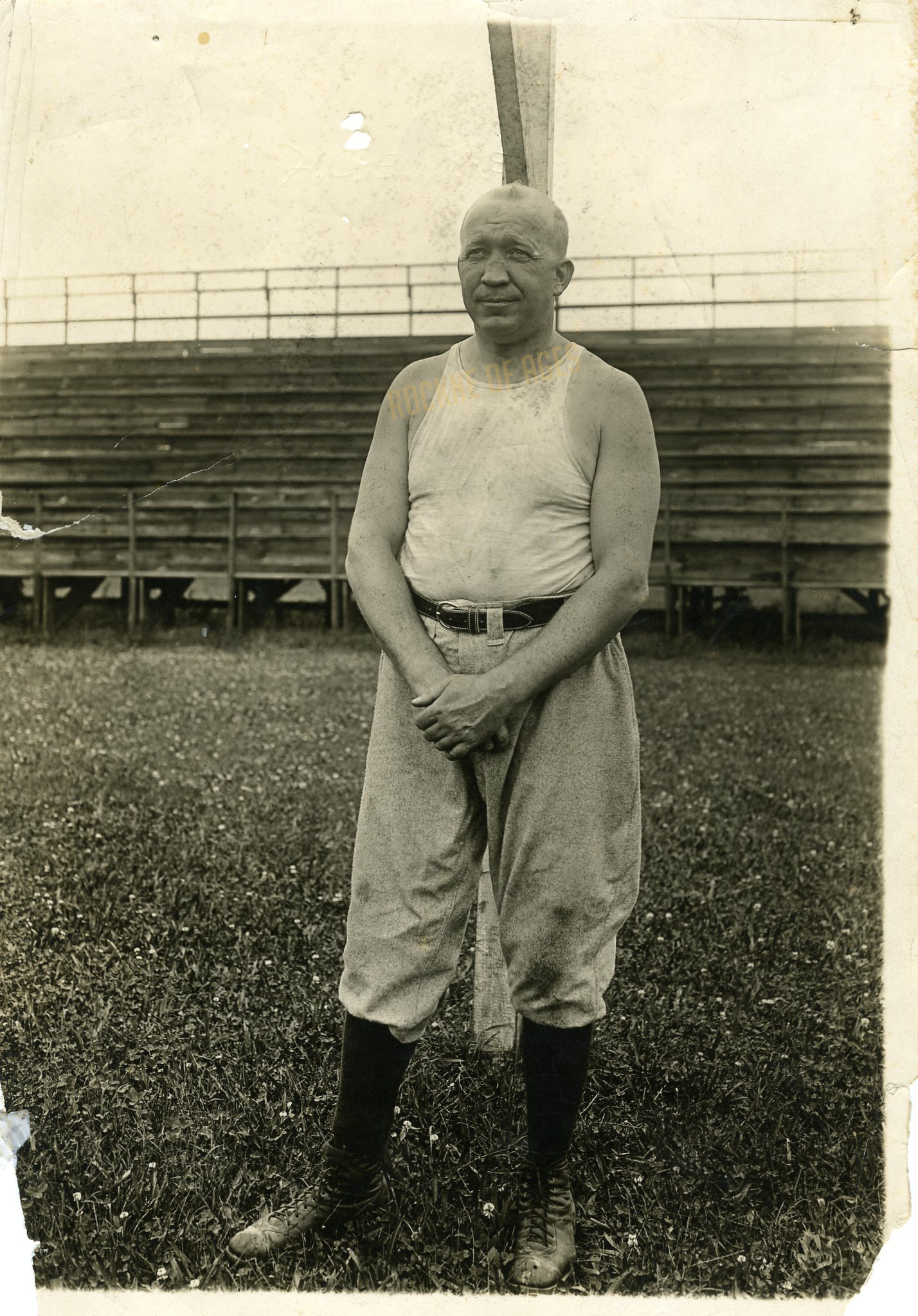 Rockne wearing baseball pants during football practice at Cartier Field.