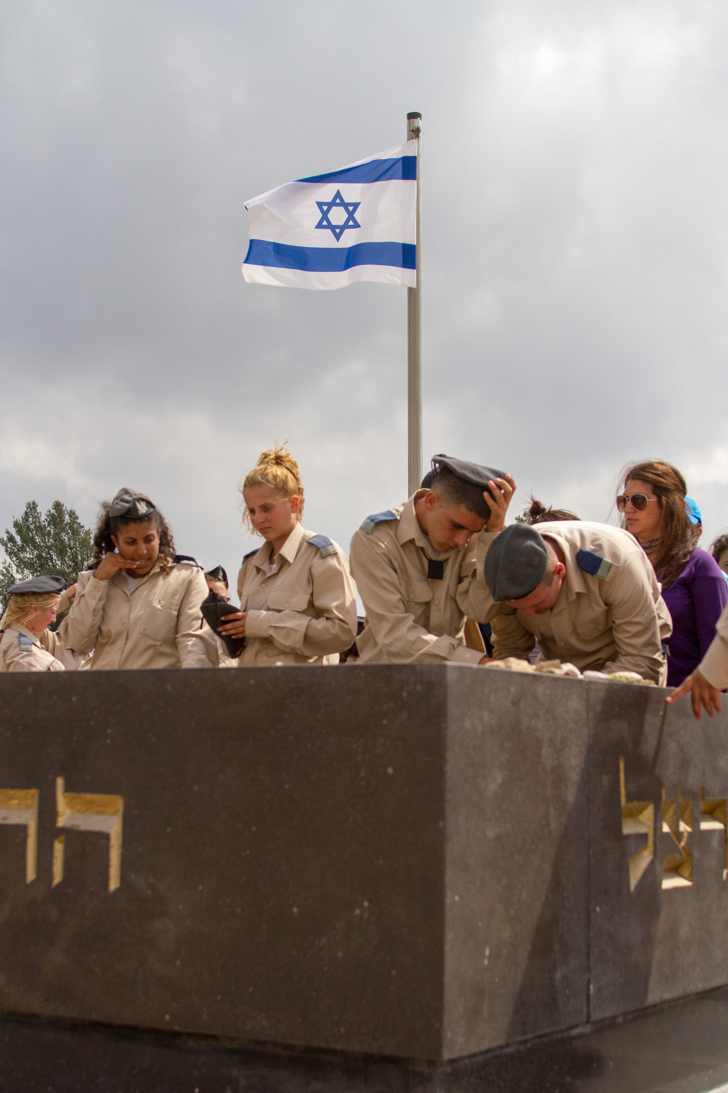 Israeli Defense Force soliders pay respects at the Yad Vashem Holocaust Museum.