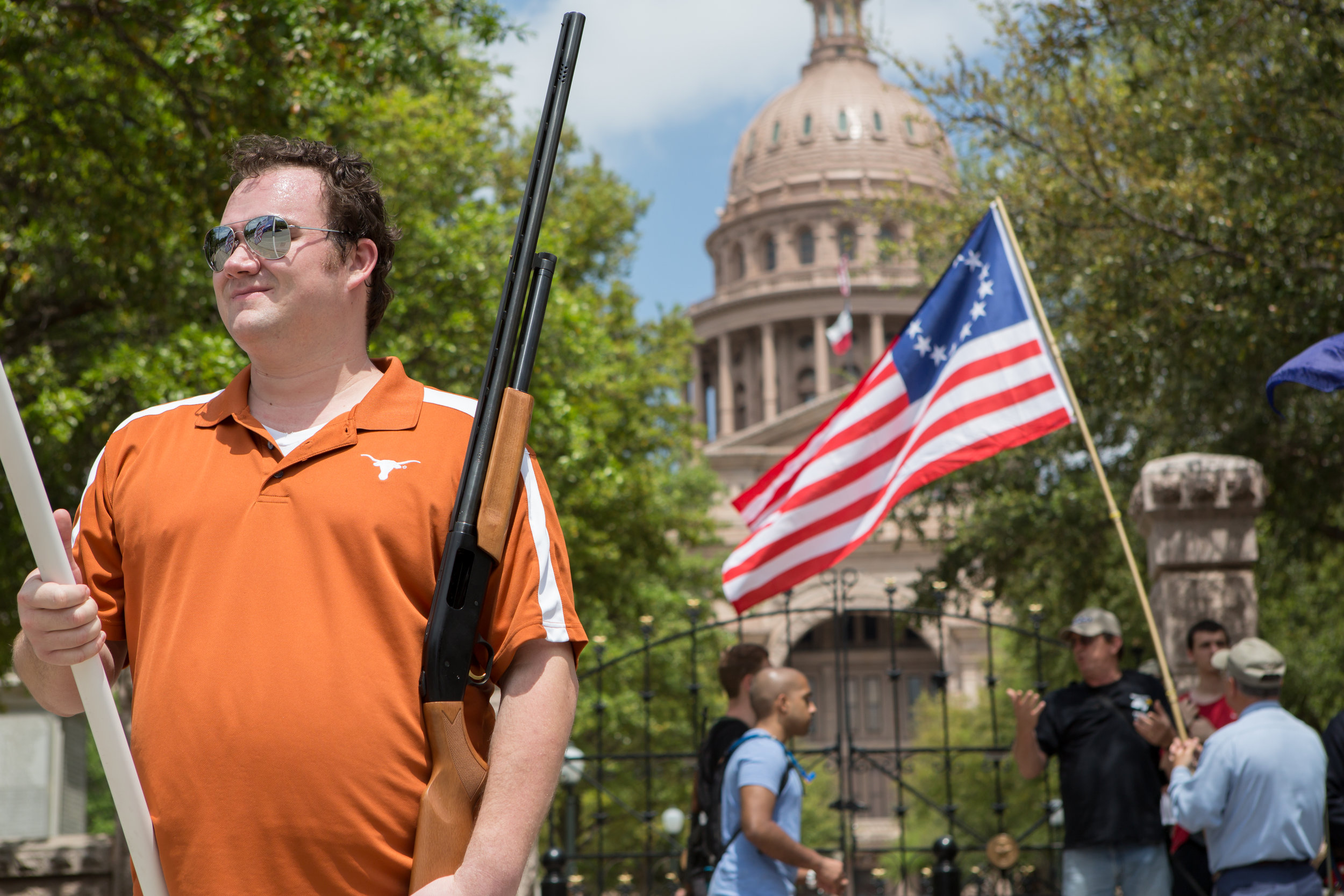 Members of Come and Take It Austin protest for the right to carry firearms without permits in front of the Texas Capitol Building.