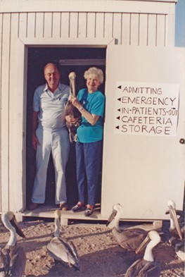 Harry & Darlene Kelton are posing in the first Seabird Station, a large tool shed.