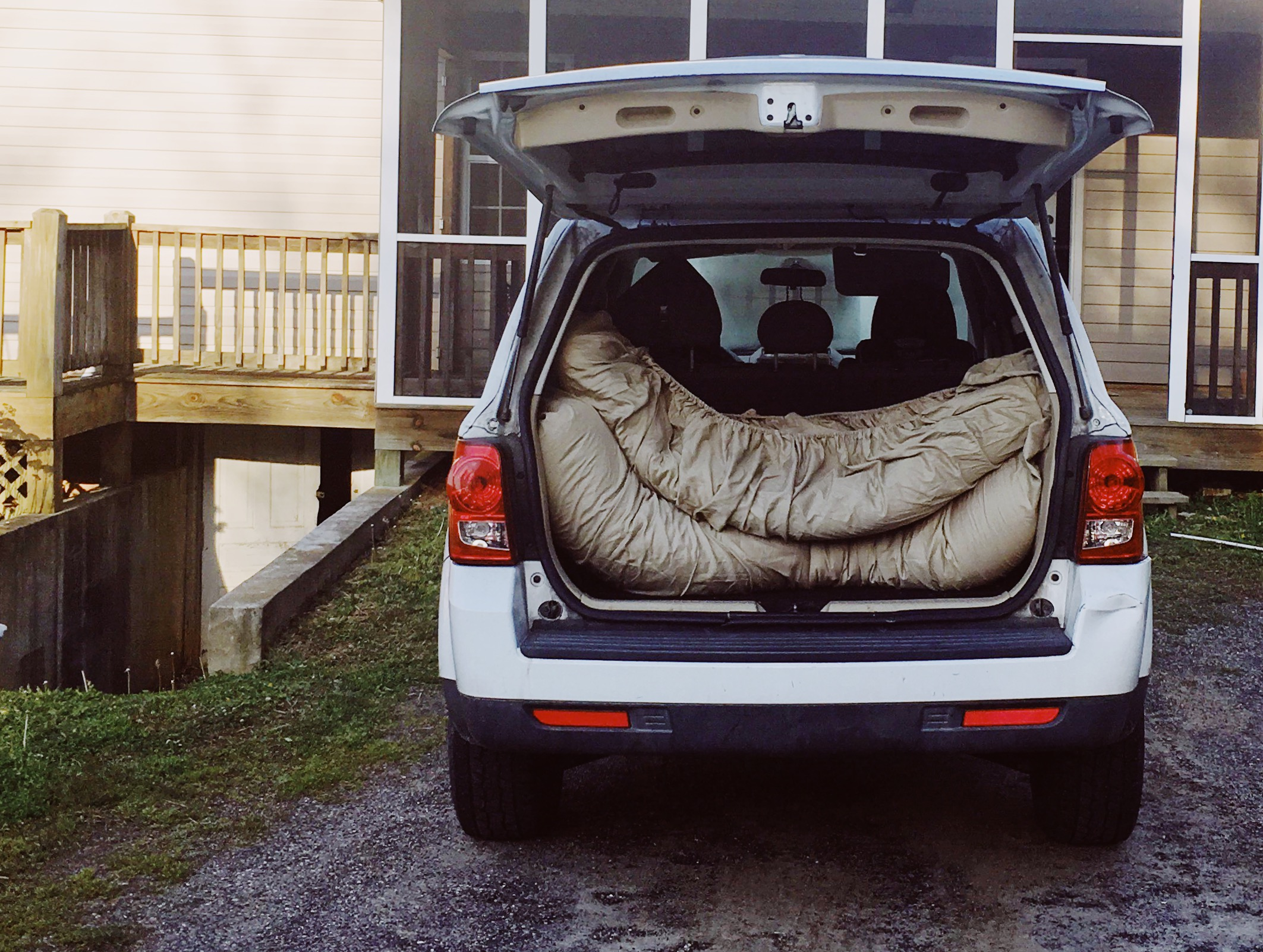 We put a fitted sheet on, folded it up and put it in the back of our car. Easy!