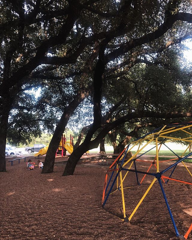 "My View ❤️⁣ ⁣ I've probably said this before..⁣ ⁣ Parents: We don't have to hover over our children at the park! Bring a book or some headphones or a yoga mat and just enjoy your time.⁣ ⁣ Apparently the average toddler hears ""no"" 400 times a day. When I bring my kids to the park, I am bringing them to a place that is literally designed FOR THEM — where they can just be free for a while.⁣ ⁣ There is no need for me to be involved at all in their play, unless they invite me and I feel a ""yes"" in my body.⁣ ⁣ I don't need to keep them safe from rocks or sticks or tiny staircases. I don't need to tell them *how* to play or use the equipment. I don't need to mediate every disagreement between my child and someone else's child. If it's not life or death, and no one is intentionally harming anyone else, I stay out of it.⁣ ⁣ They usually end up taking their shoes off and having so much fun, and I looove to watch them in their FLOW.⁣ ⁣ [Meanwhile, you can find me off in the distance, enjoying my book.. probably looking like a neglectful parent. And all three of us are happier for it! 😉]⁣"