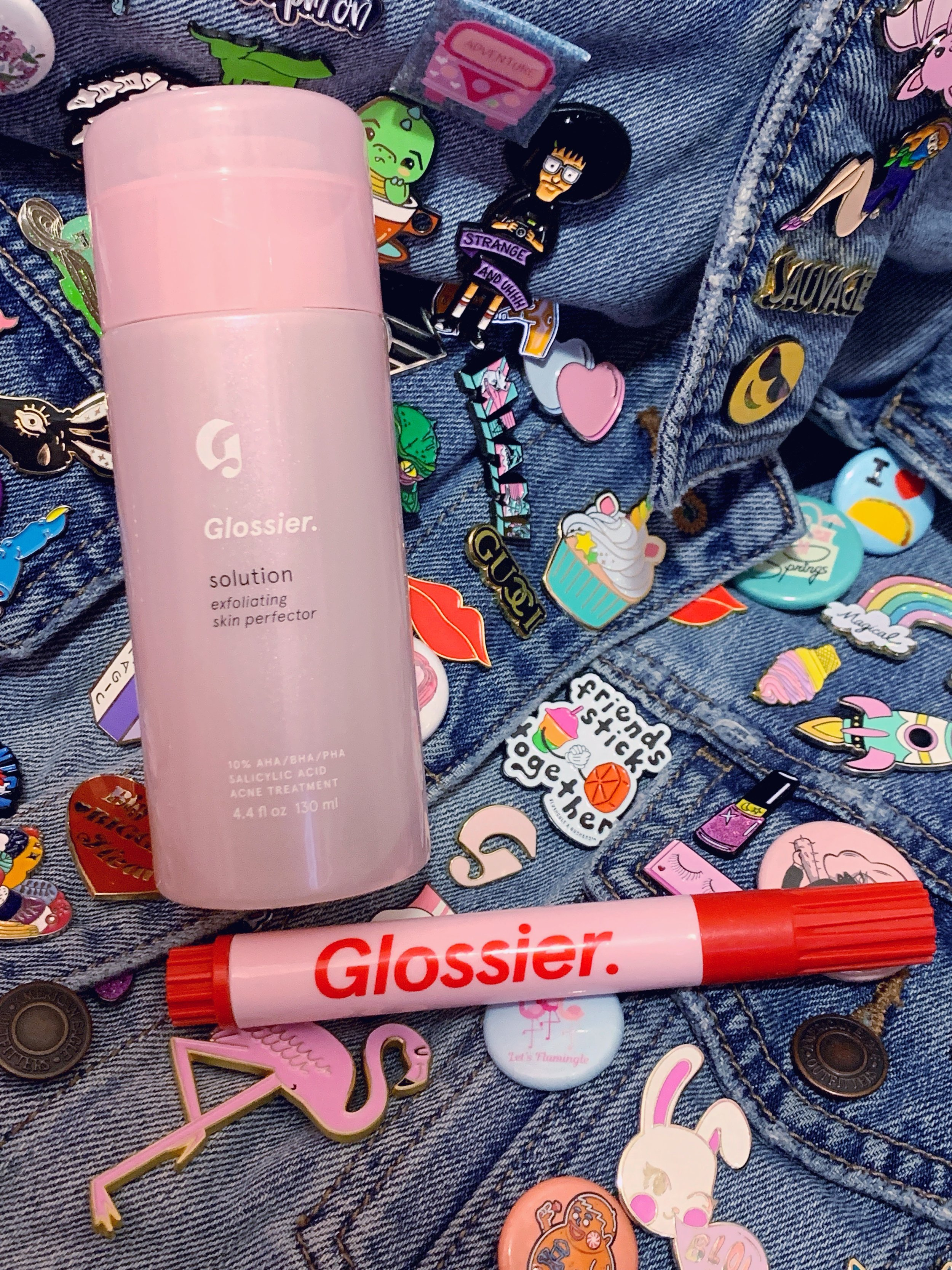 """Solution plays well with others! I also pair it with the zit stick or the """"breakout eraser"""" as Glossier playfully named this handy, purse-friendly must-have. (Cool points if you can spot the Glossier """"G"""" iconic logo. That is also available in the shop.)"""