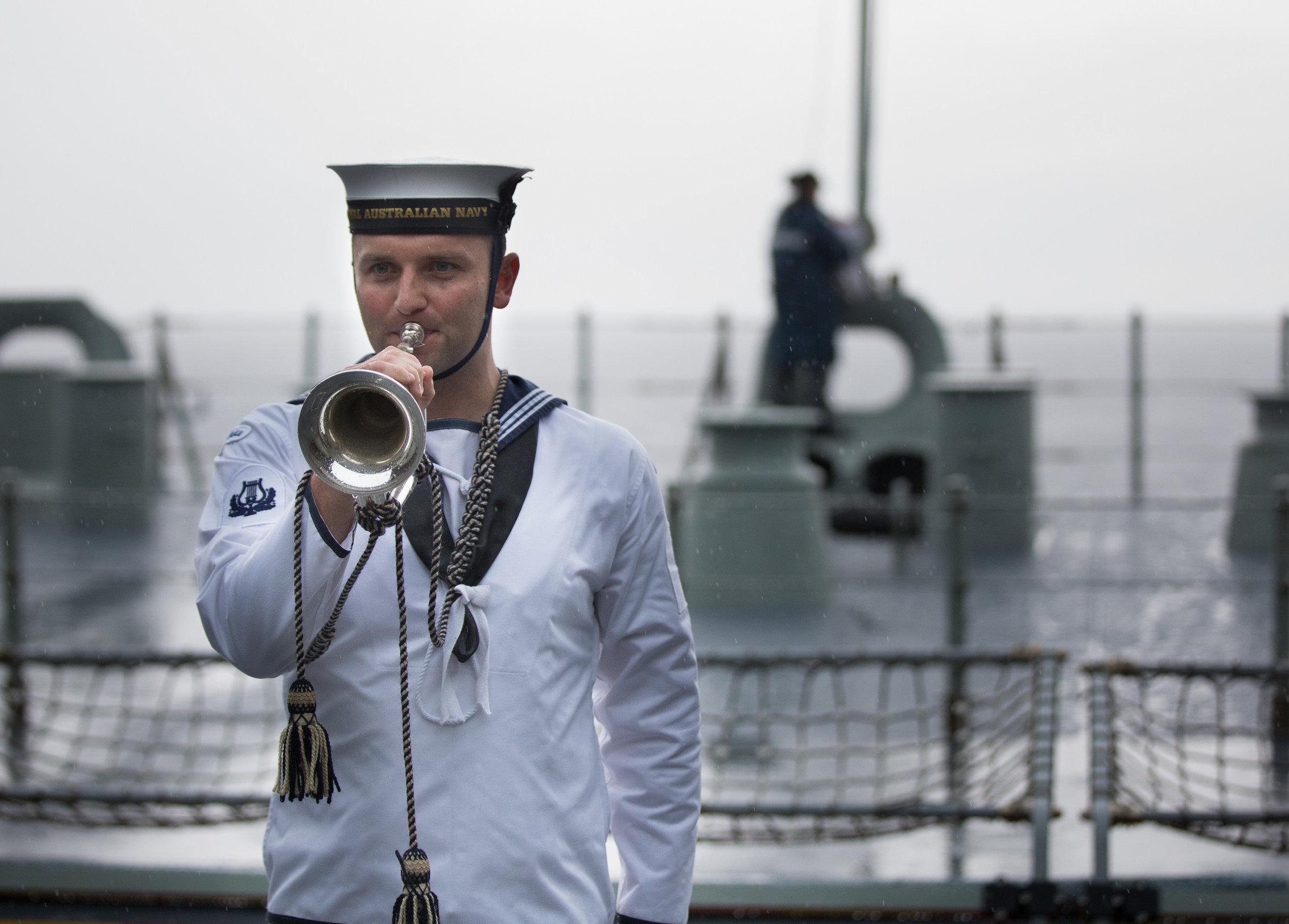 Ben plays the Last Post on HMAS Adelaide 2018