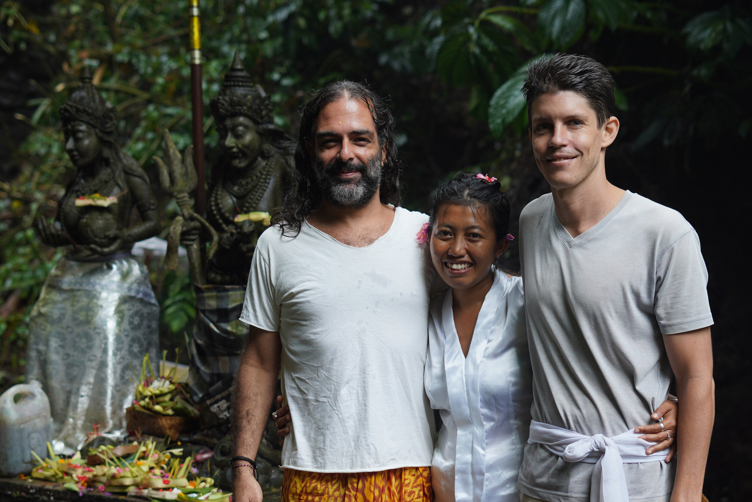 Gonçalo, Tya and Nevin in a temple in Bali, after a Melukat ceremony performed by Tya