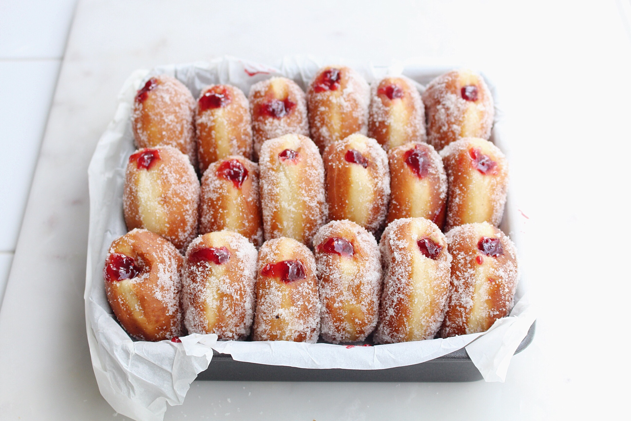 via  thesweetandsimplekitchen.com/raspberry-jam-filled-donuts-with-vanilla-sugar/