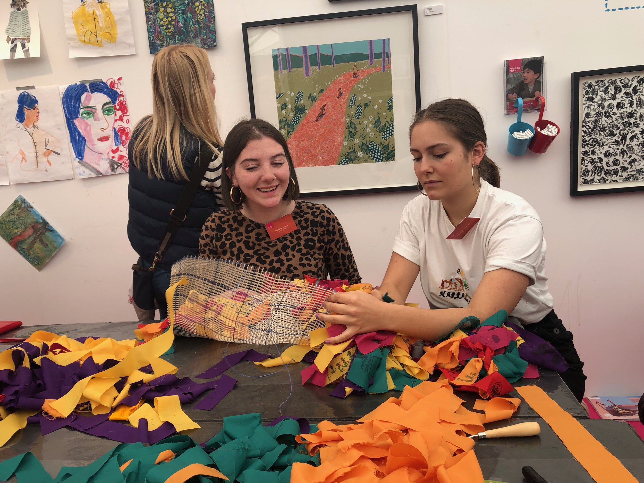 Mathilda and Molly making a rug at the space