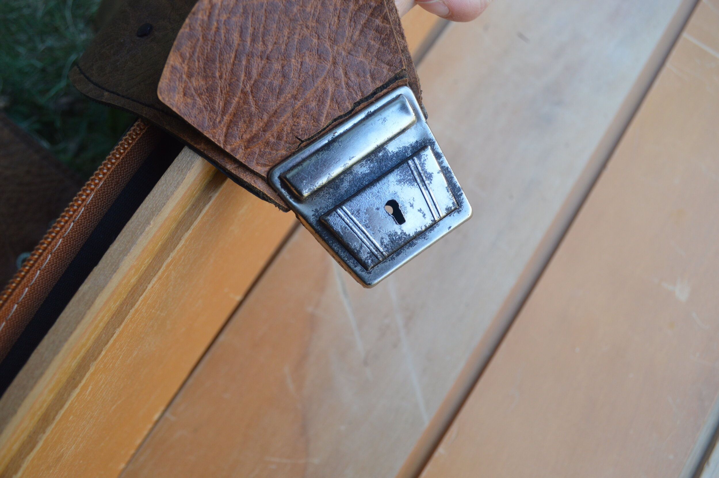 metal fastening buckle on leather suitcase strap