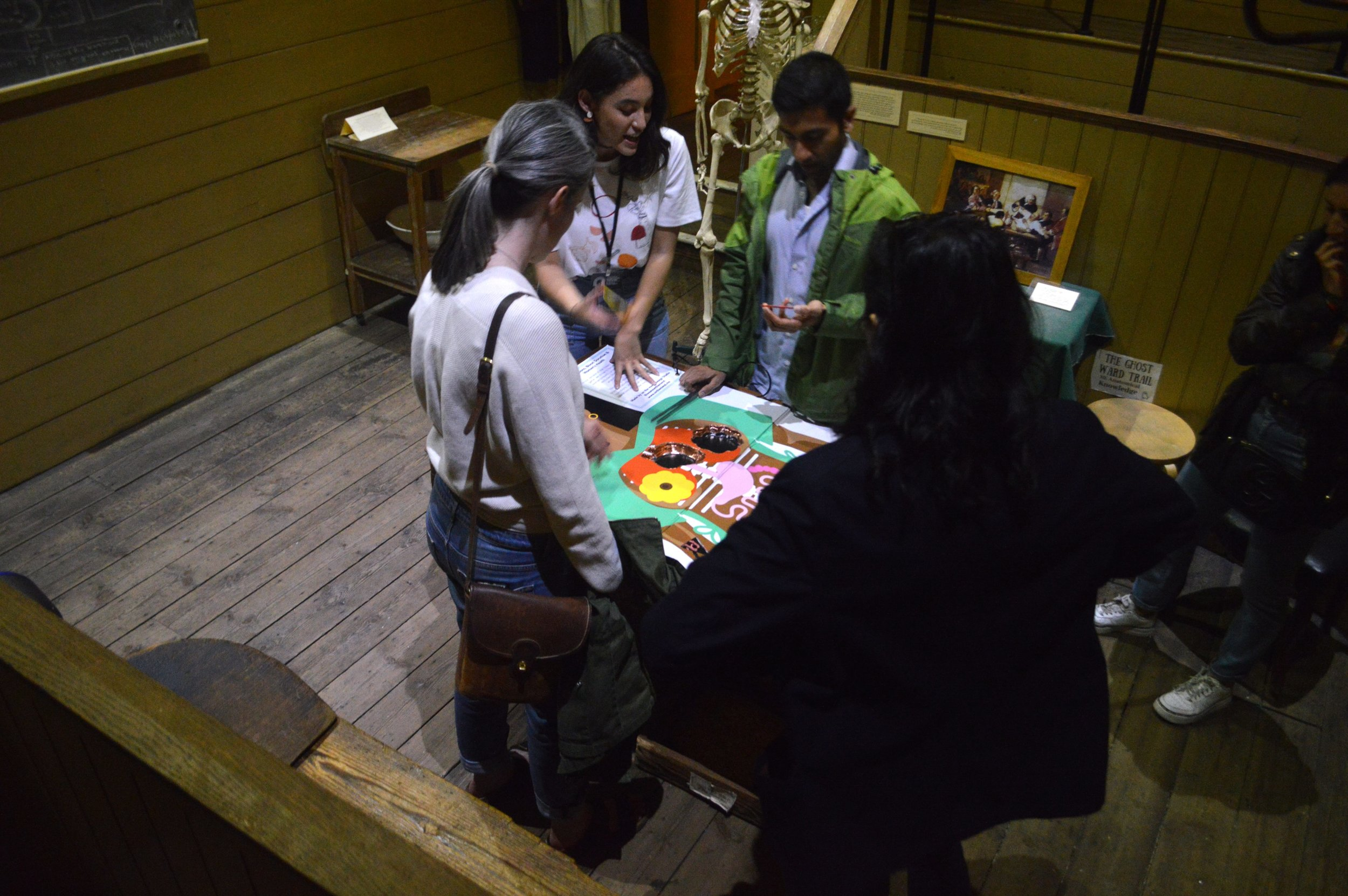 Group of people playing operation game
